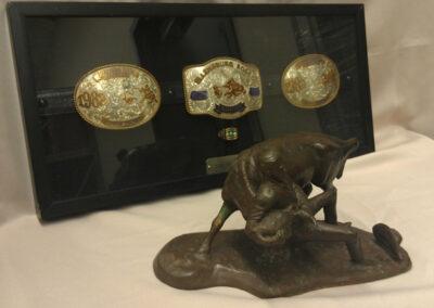 ERHOF-Buckles and Ring, Bronze Figure – Tom Ferguson.