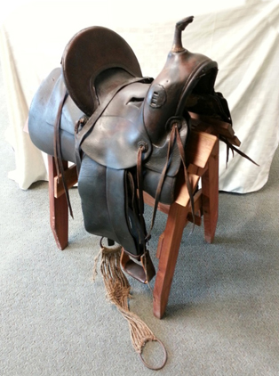 Ellensburg Tree Saddle made by Farrell Harness Shop donated by Joe Powell and Judy Kleck.